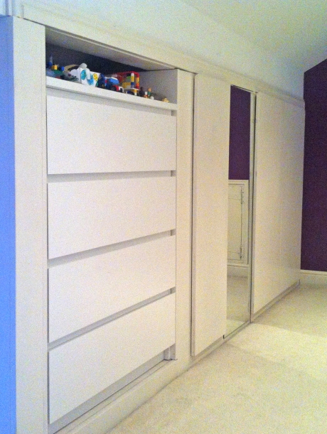 Malm drawers, wardrobe door, toy cupboard. Partitioning out the storage
