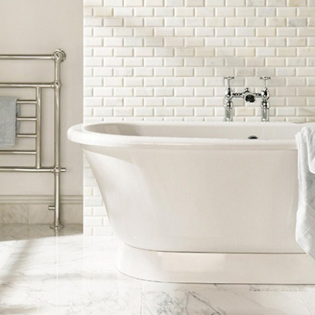 Delicately veined marble brick tiles give a translucent glow to this bathroom/ Original Style