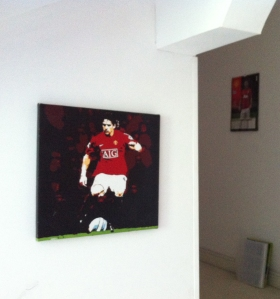 Artwork? Sure! As long as it's red. With a football /pocket money bargain and ubiquitous team calendar in background